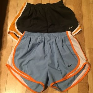 Two pairs of women's Nike tempo shorts